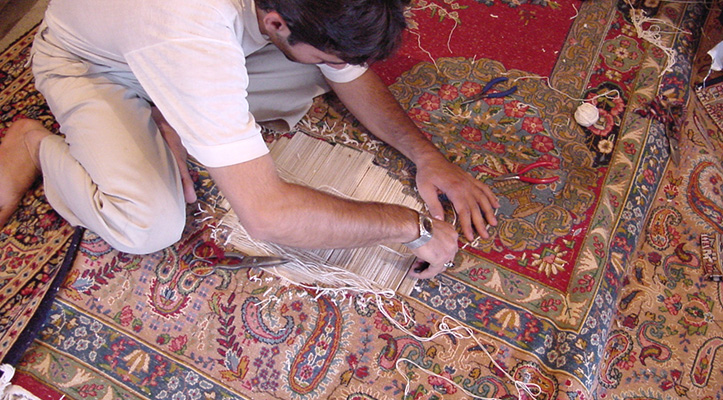 Rug Weaver Repairing an Oriengal Rug